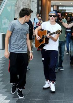 Let's casually walk around this mall playing guitars and looking like sexy mofos, okay.