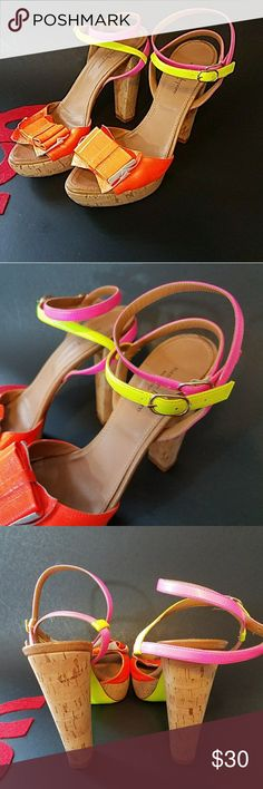 "Nanette Lepore platform sandals Gorgeous brightly colored leather sandals. Colors are bright orange, yellow and pink. Wrap around ankle straps with buckle. Cork platform and heel. Platform measures 1"" and heal measures 5"". Other than the wear on the soles, these shoes are in perfect condition. Nanette Lepore Shoes Platforms"