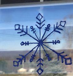 DIY Scribble Paint Snowflakes Window Clings | DIYIdeaCenter.com