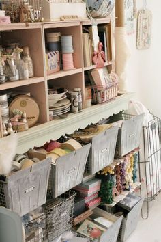 I like that in this studio things dont look perfect, but lot of practical + pretty ideas for storage. Bins + square cubbies appeal more and more to me