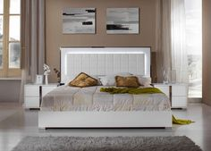 ID# VIG – VGACSANMARINO-SET   Made in Italy, the San Marino white bedroom set is contrived of the best quality materials and is designed to reinvent your home. The body of the San Marino is finished in a marvelous white gloss lacquer. The eco-leather tufted headboard is trimmed in chrome finish and adorned with LED lights to enhance the focal point. Another popular feature includes a solid melamine wood platform which takes the place of standard slats and creates a sturdier base for the…