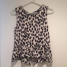 Black and white top with ruffle at the bottom Zips up the back Tops