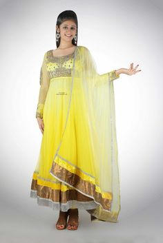 Ombre dyed Floor Length Anarkali in a neon yellow color with a deep scoop back and rouged fitted sleeves. The entire Neon Yellow Ombre Anarkali is made in soft tulle nett with intricate crystal embroidery. The outfit comes with a matching stole and a stretch fit lycra cheddar.  Buy online: http://www.adsingh.com/product/neon-yellow-ombre-anarkali/ email: Info@adsingh.com www.twitter.com/adsinghdesigns