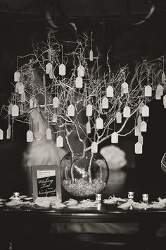 Hanging, wishing tree, Could be centerpiece on table surrounded by votives.  Guests could add wedding wishes!
