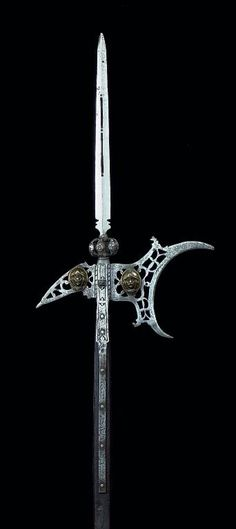 A rare italian halberd, early 17th century, probably venetian with broad central blade pierced with a pair of slots,