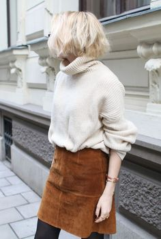 Oversized turtleneck and brown suede mini skirt with black tights | Image via bloglovin.com
