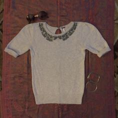 Free people half sleeve sweater Beautiful half sleeve cream bead embroidered sweater. Excellent condition, only worn a few times. Soft and form fitting. Extra small. Free People Sweaters