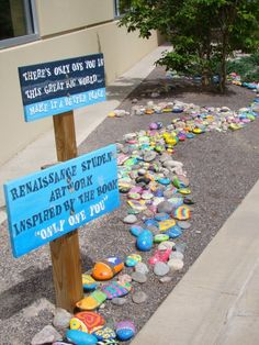Painted rocks could separate the trees/bushes and grass.... also like the idea of colorful signs.