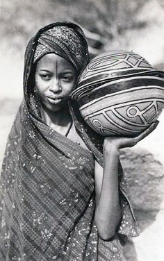 Africa | Fulani/Foulbe woman with decorated calabash bowls  Cameroon.  ca. 1940s/50s || Scanned postcard.  Photo by R Pauleau, Douala.