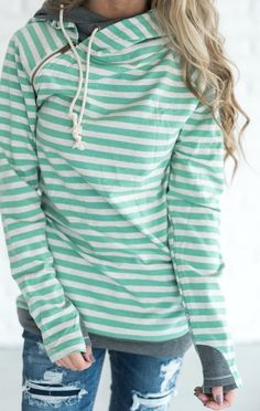 A soft & lightweight hoodie. Mint Green & Oatmeal stripes with Charcoal accents. This hooded sweatshirt features: zipper shoulder detail, hidden thumbholes and pockets, and double hood with play in fr