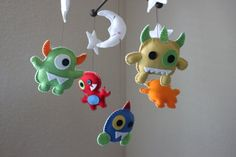 "Myles needs one of these cute mobiles for his ""Baby Monster"" themed nursery.  This adorable creation comes from ""dropsofcolorshop"" on Etsy."