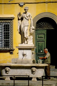Filling up at the Fountain,  Lucca,  Tuscany,  Italy by David May, via Flickr
