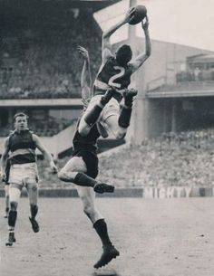 Mervyn Hobbs making one of the highest marks taken by a little player. Footscray rover Merv Hobbs flies over Melbourne's ...