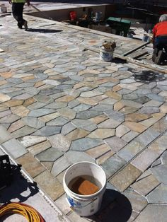 Quartzite getting prepared for grout at the Island Colony Pool Deck in Honolulu, HI.  Photo courtesy of Bob Stark of Sunset Tile & Stone.