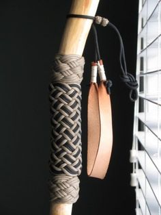 Leather wrist strap on a paracord-wrapped hiking stick. Great combo of three of my passions...leather-crafting, knotwork, and outdoor recreation!