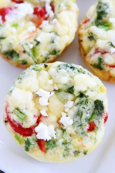 Egg Muffins with Kale, Roasted Red Peppers, and Feta Cheese Recipe on twopeasandtheirpod.com These healthy egg muffins are great for busy mornings!