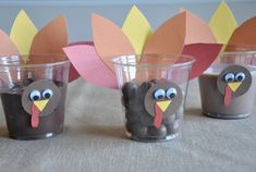 Turkey Treat Cups! :) Quick, last minute favor cups....simply cut construction paper, glue eyes, add your favorite treat! :) Via: http://www.kidskubby.com/50-cute-thanksgiving-treats/