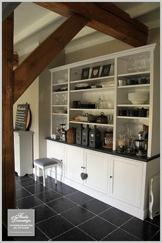 combination slate coloured floor with white cupboards and wood/neutral baskets, containers Rustic Kitchen, Kitchen Dining, Kitchen Decor, Kitchen Cabinets, Dining Room, Kitchen Trends, Kitchen Ideas, White Cupboards, Cocinas Kitchen