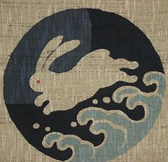 """A white rabbit crossed the ocean from Kino Island to the mainland at Inaba by using the backs of sharks as stepping stones and thus appeared to be running over the tops of the waves. This story became the theme of a Noh song that translates roughly, """"While the moon floats over the ocean, a rabbit runs over the waves--what interesting island scenery""""."""