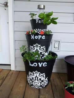 """Pinterest inspired creation! Plastic planters decorated with templates & hand written """"Faith Hope Love"""". It's my Mom's Mother's Day present!!"""