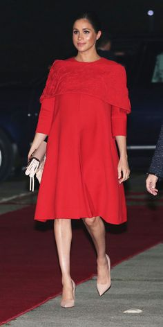 Pregnant Meghan Markle Stuns in Valentino for Morocco Arrival with Prince Harry: Photo Prince Harry holds hands with his wife Meghan Markle, the Duchess of Sussex, while arriving at Casablanca Airport on Saturday evening (February in Casablanca,… Beauty And Fashion, Royal Fashion, Star Fashion, Fashion News, Fashion Looks, Fashion Outfits, Vestidos Valentino, Red Valentino Dress, Prince Harry