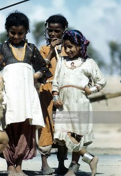 A view of local children wearing regional clothes pose in the street in Benghazi, Libya.