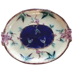 A Victorian Majolica oval platter decorated with a molded bamboo edge, bows and blossom. Circa 1875. It measures 13' long by 10.25' wide. There are no makers marks. There is the usual overall crazing. There is a 1' spider crack on back edge which does not show from the front. No other damage noted. A good looking platter. Victorian Life, English Pottery, Thing 1, Makers Mark, Platter, Spider, Bamboo, How To Look Better, Bows