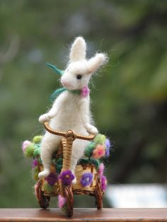 Needle felted white bunny riding bike, spring home decoration. $82.00, via Etsy.