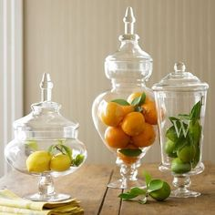 Apothecary jars with citrus, lemon, orange and lime
