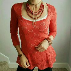 Eyelet Design Free People top!! Truly beautiful detailing on this from the eyelet material to the darted bottom! The top is a reddish/orange color! So bright and pretty for Spring  Free People Tops
