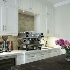 This. White shaker cabinets, backslash, but sage green walls and dark counter. Espresso machine would be nice, too!