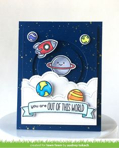 the Lawn Fawn blog: Slide on Over Circles  I stamped, colored and diecut images from Out Of This World, and arranged them, popping each one up with foam tape.  I stamped a sentiment from the same set on to a stamped banner from the Bannerific stamp set and diecut it with coordinating dies before popping it up with foam tape.  To finish things off, I added accents with a white  gel pen