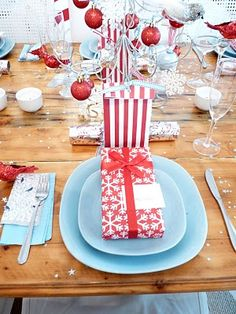 Pretty and simple Christmas table - love the pale blue and red Would go great with my new dishes