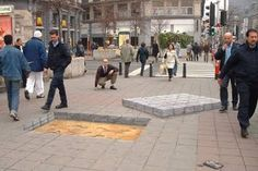 """Step up and step down on a level walk = """"Julian Beever is an English artist, who makes humorous drawings on sidewalks using pastel chalk. His designs and cause optical illusion seem real."""""""