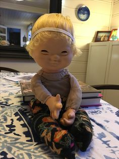 My very own Tonino, getting a makeover. I just made him a pair of tights from a sock, fixed and softened his hair with fabric softener, and now he's waiting for a new little sweater or jacket.