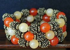 Hey, I found this really awesome Etsy listing at https://www.etsy.com/uk/listing/225681368/memory-wire-multi-coil-bracelet-orange
