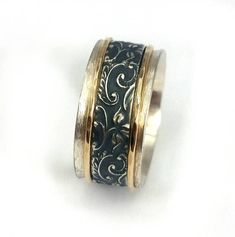 Unusual spinner ring, unisex wedding band, wide spinner, oxidized sterling silver band, yellow gold rotating hoops, Ilan Amir
