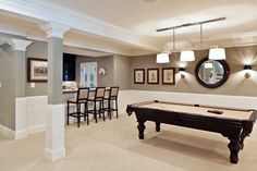 Basement Remodeling Pictures With Beige Carpet And Pool Table Plus Wall Paneling With Best Grey Paint Colors And Bar Stools With Wall Sconces