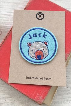 Label your kids stuff in style with this unique personalised name patch with a cute bear design. Perfect for decorating clothing, camp blankets or school pencil cases and bags. Kids Name Labels, Custom Name Patches, Embroidered Name Patches, School Pencil Case, Bear Head, Camping Blanket, Pennant Banners, Bear Design, Cute Backpacks
