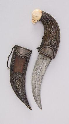 Dagger (Jambiya) with Sheath Date: 19th century Culture: Indian Medium: Steel, silver, wood, ivory