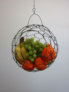 CustomMade by David Charest: This hanging wire basket was designed for fruit or vegetables. This one was about 10 inches wide. It has an 18 inch swiveled steel leader and a Shook for hanging. I can make these in different sizes and with different hanging options.