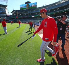 Shohei Ohtani: Japan's two-way star - Shohei Ohtani takes the field to warm up before the Angels' season-opener against the Athletics at Oakland Alameda Coliseum in Oakland on March Ben Margot, AP Basketball Goals, Soccer, Nippon Professional Baseball, Opening Day Baseball, Mike Trout, Angel S, Baseball Games, Oakland Athletics, Futbol
