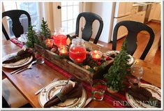 Christmas table set with a rustic, casual arrangement.  LOVE that look!