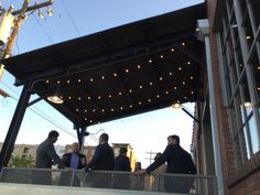 What a cool welcome, the front porch at The Rickhouse with Get Lit Market Lights.