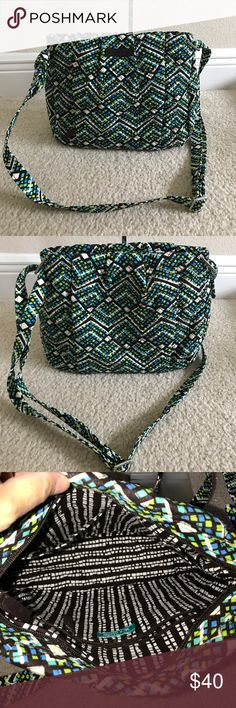 """VeraBradley SignaturePrint Hadley CrossbodyHandbag Like new color rain forest.Style: Hadley Lightweight, one zip pocket, silvertone hardware, crossbody design Interior zip pocket and two slip pockets Measures approximately 12-1/2""""W x 10""""H x 3-1/2""""D with a 14-1/2"""" to 28"""" strap drop; weighs approximately 7 oz Face 100% cotton; fill/trim 100% polyurethane; lining 100% cotton; zipper pulls 100% polyurethane plaque Vera Bradley Bags Crossbody Bags"""