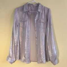 "❤️ Amazing Silver Calvin Klein Split-neck Blouse❤️  Amazing Silver Metallic Blouse, button tab- roll sleeves, about 27"" from shoulder to hem, Polyester, Hand wash Perfect condition worn once Calvin Klein Tops Blouses"