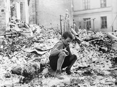 A young Polish boy returns to what was his home and squats among the ruins during a pause in the German air raids on Warsaw, Poland, in September of 1939. German attacks lasted until Warsaw surrendered on September 28. One week later, the last of the Polish forces capitulated near Lublin, giving full control of Poland to Germany and the Soviet Union.