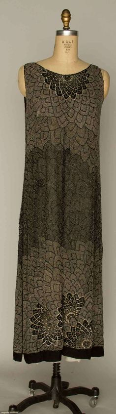 """BEADED EVENING DRESS, Black and silver beads in all over flower burst & scallop pattern, B """", L """", (several small areas have been crudely rebeaded) very good. via Augusta Auctions 20s Fashion, Fashion History, Art Deco Fashion, Vintage Fashion, Beaded Evening Gowns, Evening Dresses, Vintage Dresses, Vintage Outfits, Jugendstil Design"""