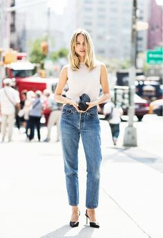 A ribbed tank top is worn with blue jeans and slingback heels