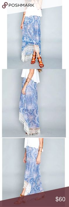"""•nwt• show me your mumu tulum skirt in magic NWT maxi skirt with high low style and pretty floral patter, white fringe all along the bottom and elastic waist makes this super comfy. Could be worn as a skirt, dress or swim cover up. Waist 12.5"""". Length at longest 49"""" Show Me Your MuMu Skirts Maxi"""